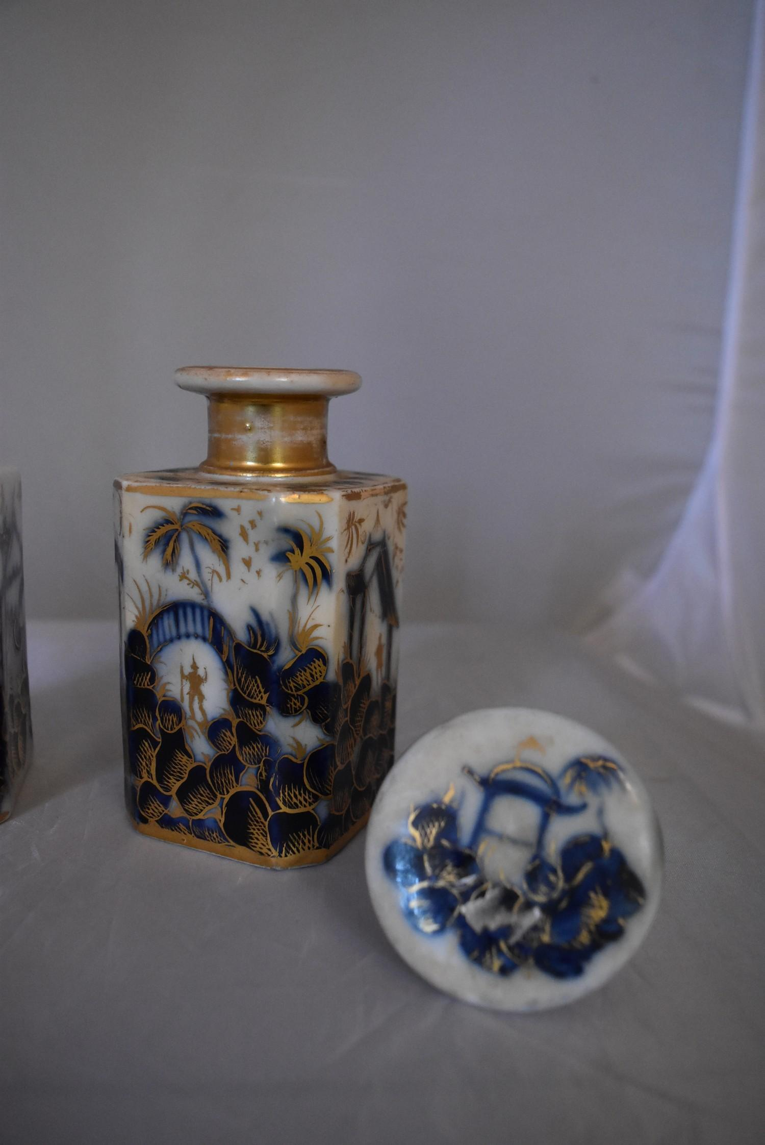A pair of blue and white French porcelain scent bottles with oriental design and gilded accents. - Image 3 of 6