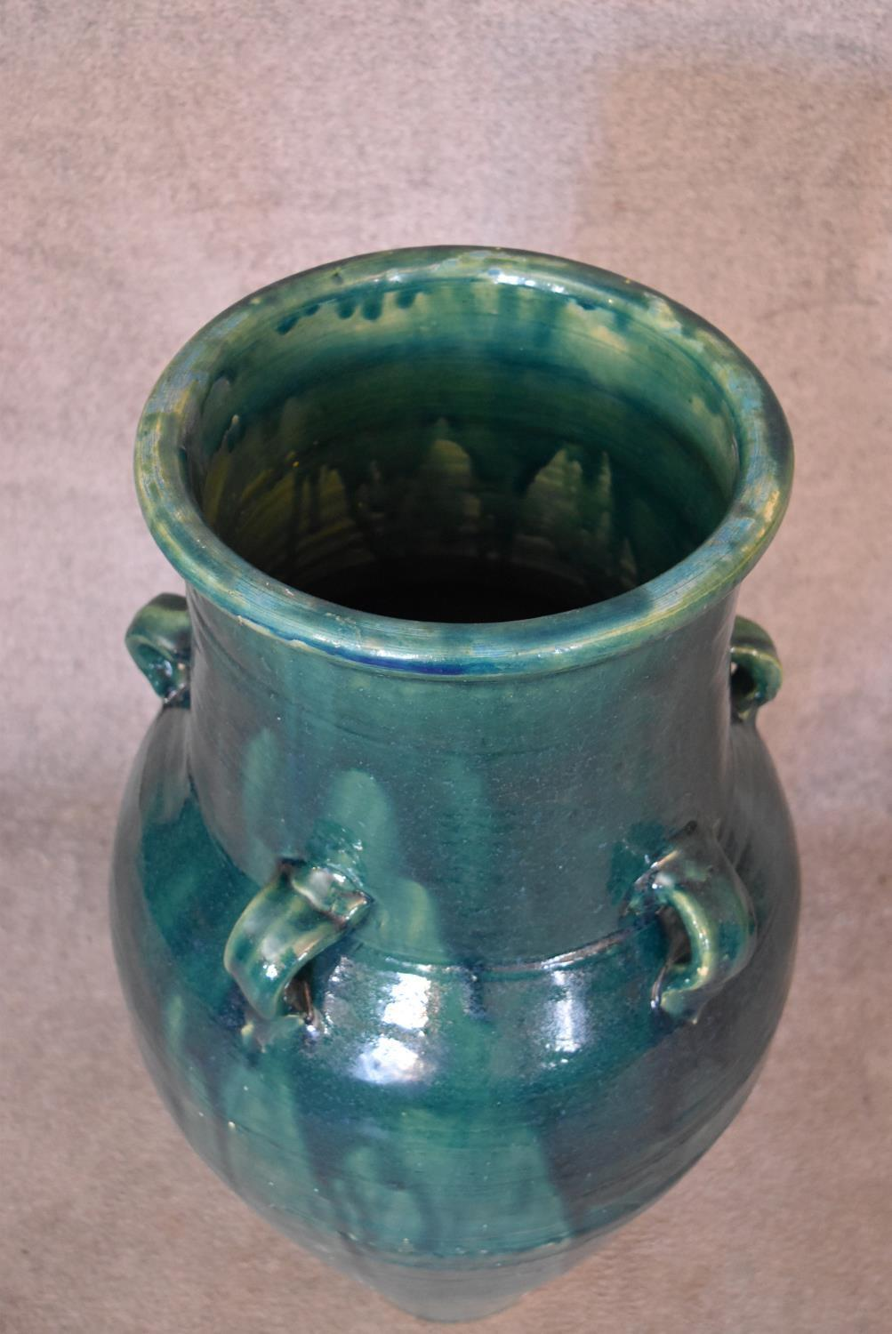 A large green drip glazed sharab wine vessel with six handles. H.93 x 30cm - Image 2 of 4