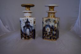 A pair of blue and white French porcelain scent bottles with oriental design and gilded accents.