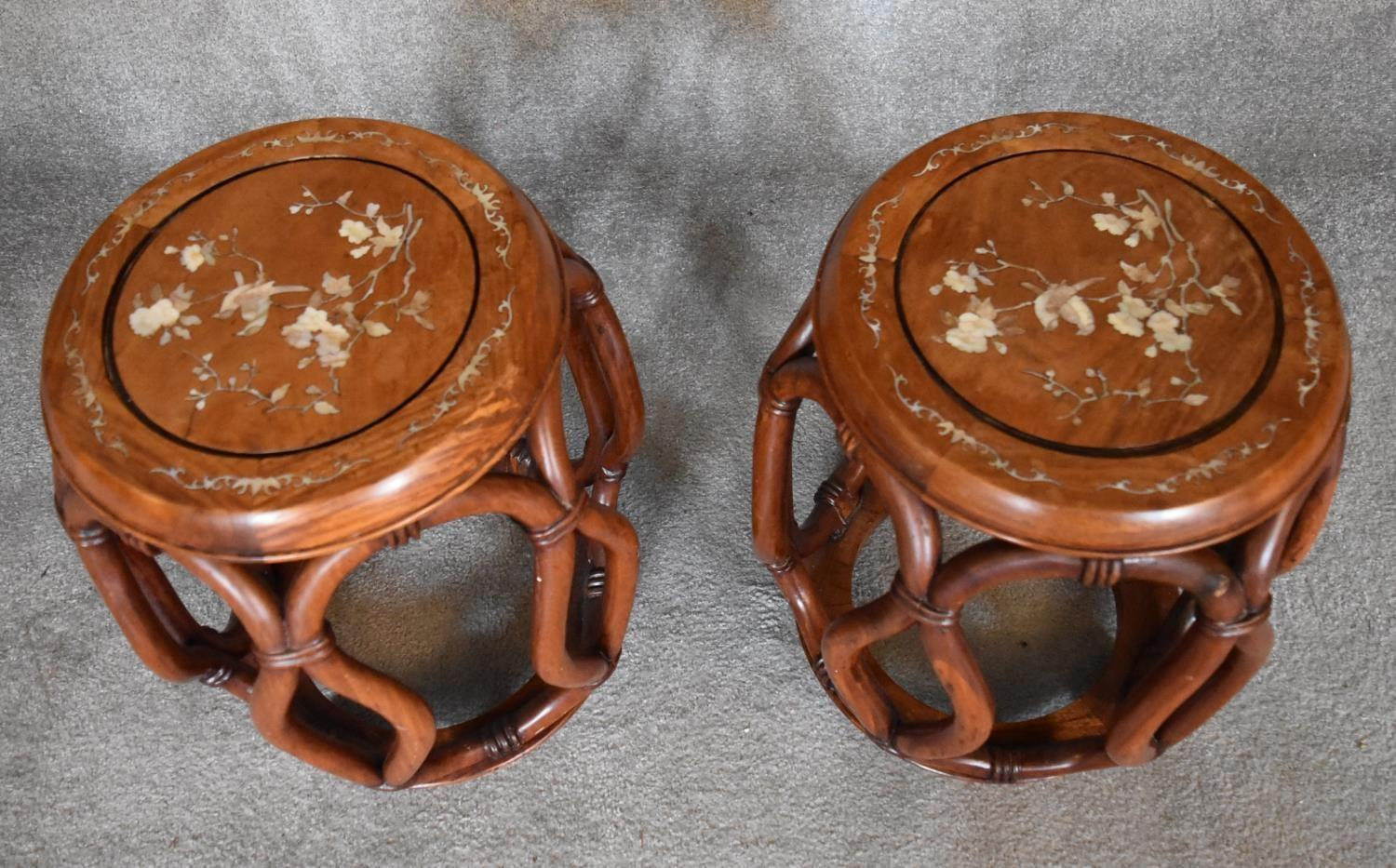 A pair of Chinese rosewood and mother of pearl inlaid barrel shaped stools with latticework sides. - Image 2 of 4