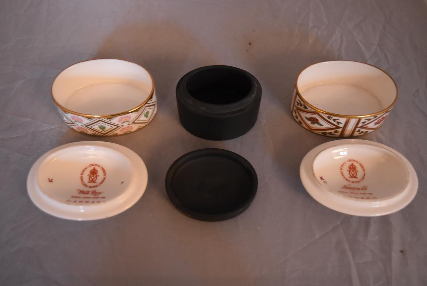 Three bone china and ceramic trinket boxes. Two by Royal Crown Derby, Wild Rose and Honeysuckle - Image 2 of 4