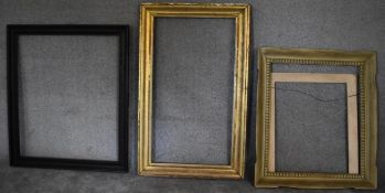 A gilt frame by Brooks, label verso, a carved frame and another. H.129 x 80cm (largest)