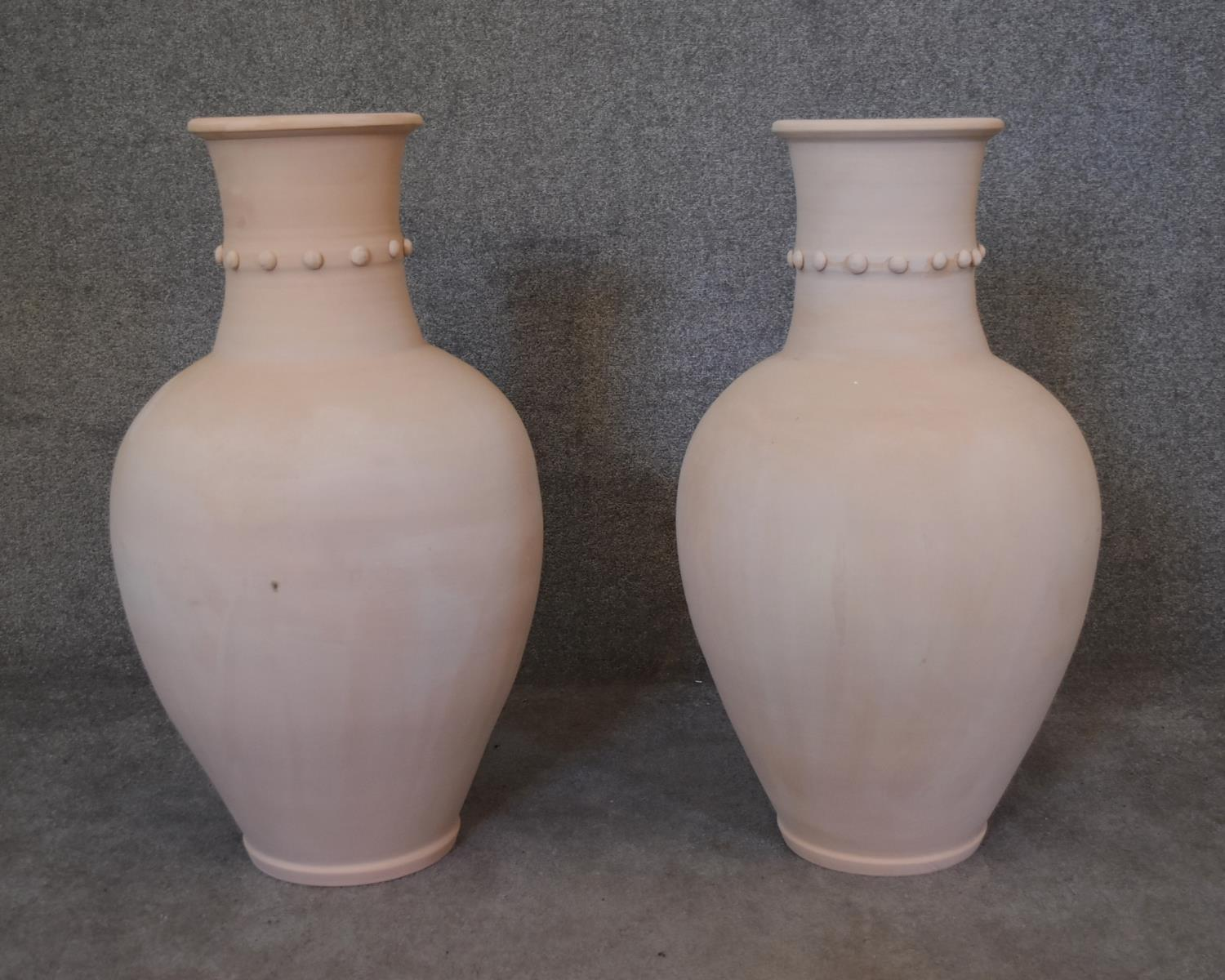 A large pair of Persian Hamadan storage pots with studded collars. H.85 x 50cm
