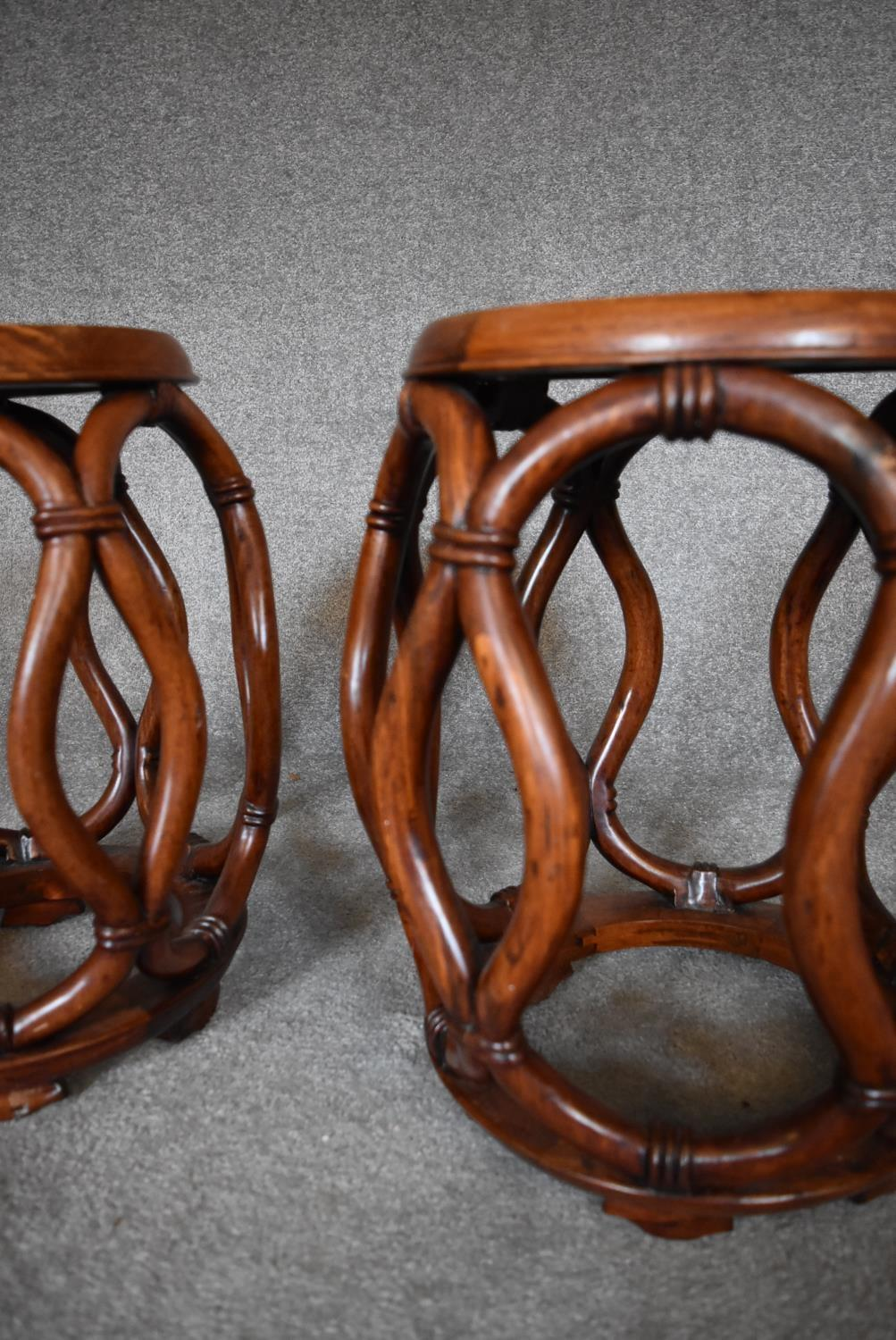 A pair of Chinese rosewood and mother of pearl inlaid barrel shaped stools with latticework sides. - Image 4 of 4