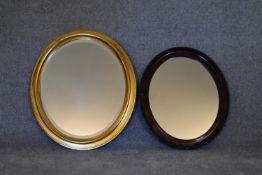 An oval gilt framed mirror and another similar. H.72 x 62cm
