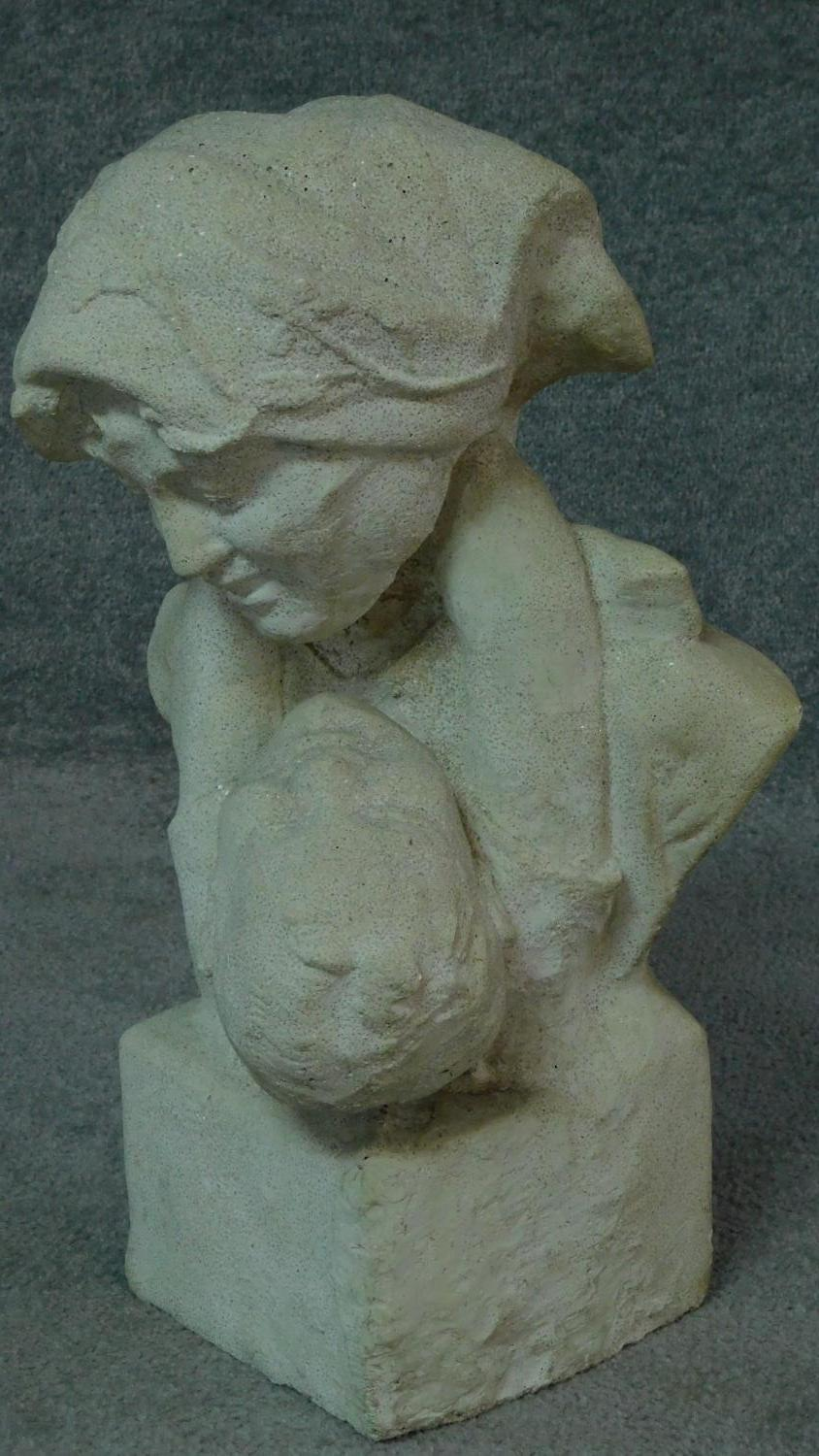 A stone bust of mother and child, the mother is looking down at her son who has his arms around - Image 2 of 5