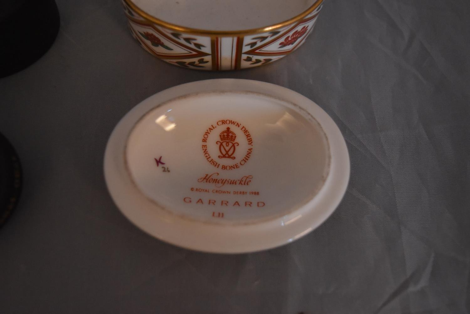 Three bone china and ceramic trinket boxes. Two by Royal Crown Derby, Wild Rose and Honeysuckle - Image 3 of 4