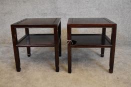 A pair of Chinese rosewood low tables on square section supports united by undertier. H.40 x 36cm