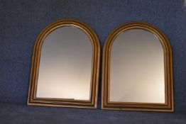 A pair of Victorian style arched gilt mantel mirrors. H.80 x 60cm