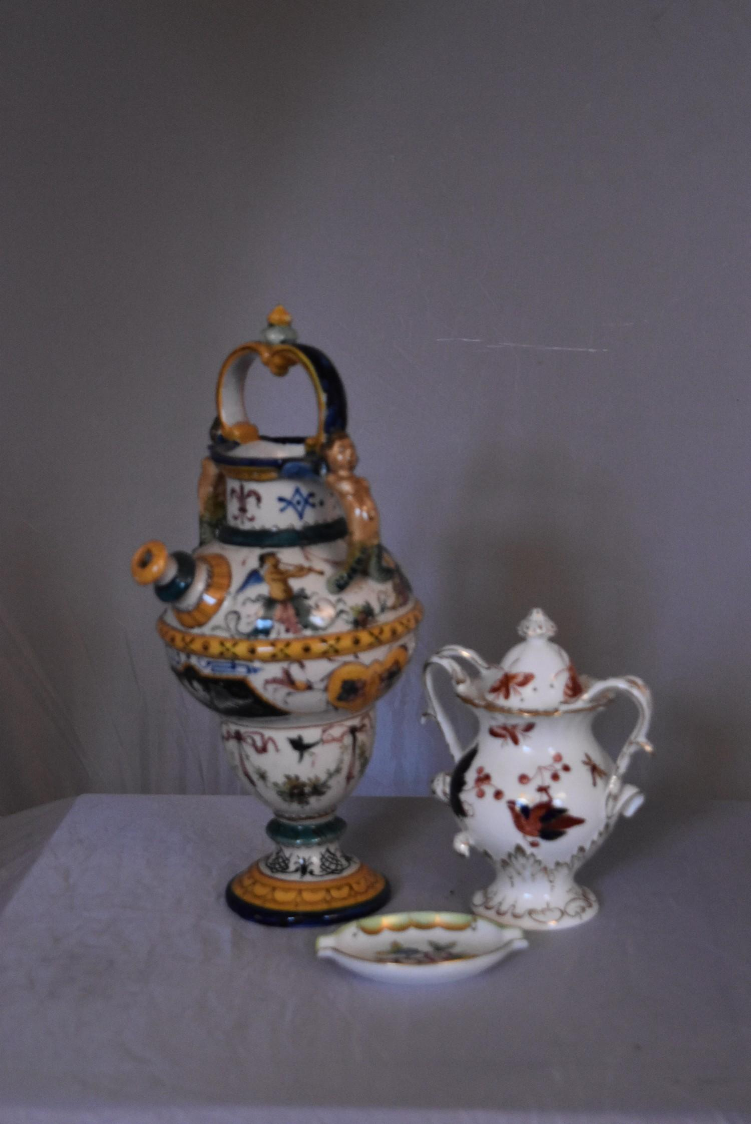 A collection of hand painted porcelain and ceramics. One Herend Ash tray with floral design and