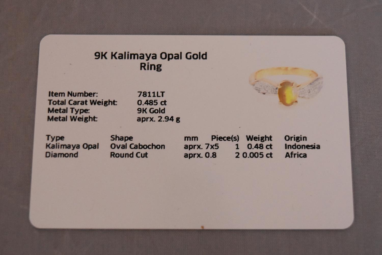 A modern Kalimaya opal and diamond flanked solitaire ring. Set to centre with an oval cabochon - Image 3 of 7