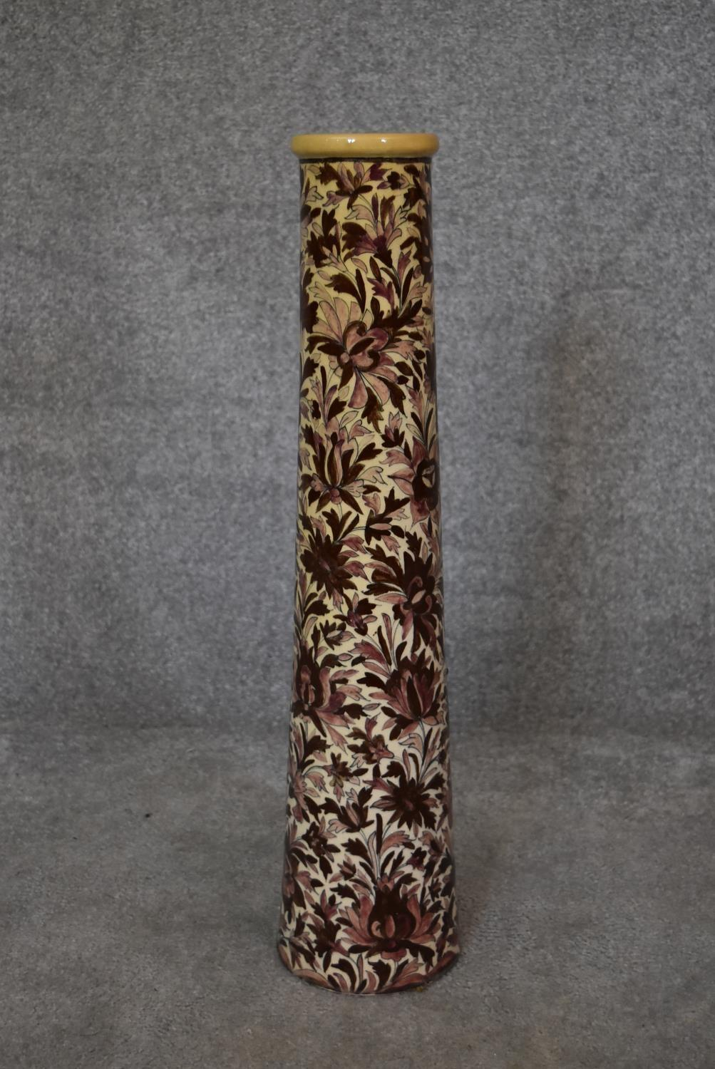 A Persian Isfahan bamboo vase, decorated with stylised flowers. H.70cm