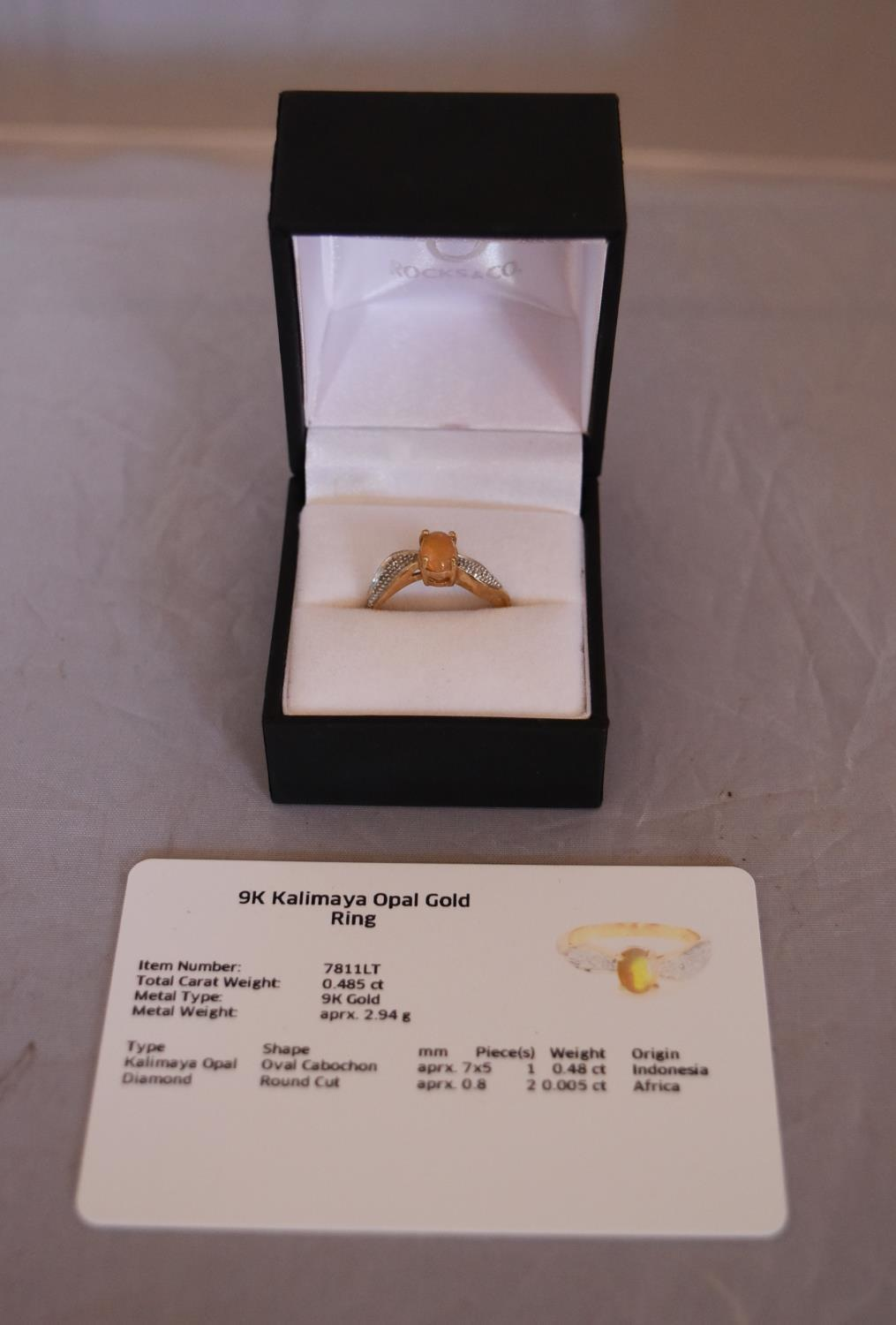 A modern Kalimaya opal and diamond flanked solitaire ring. Set to centre with an oval cabochon - Image 2 of 7