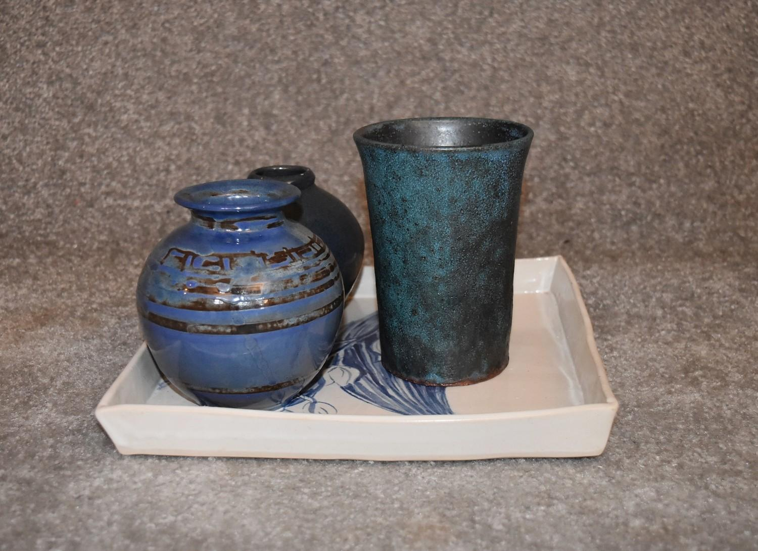 Three art pottery vases and an art pottery platter with blue glazed floral decoration. Tallest H. cm