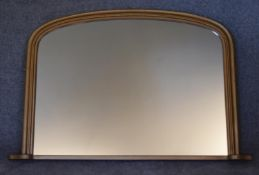 A Victorian style arched top gilt framed overmantel mirror. H.82 x 110cm