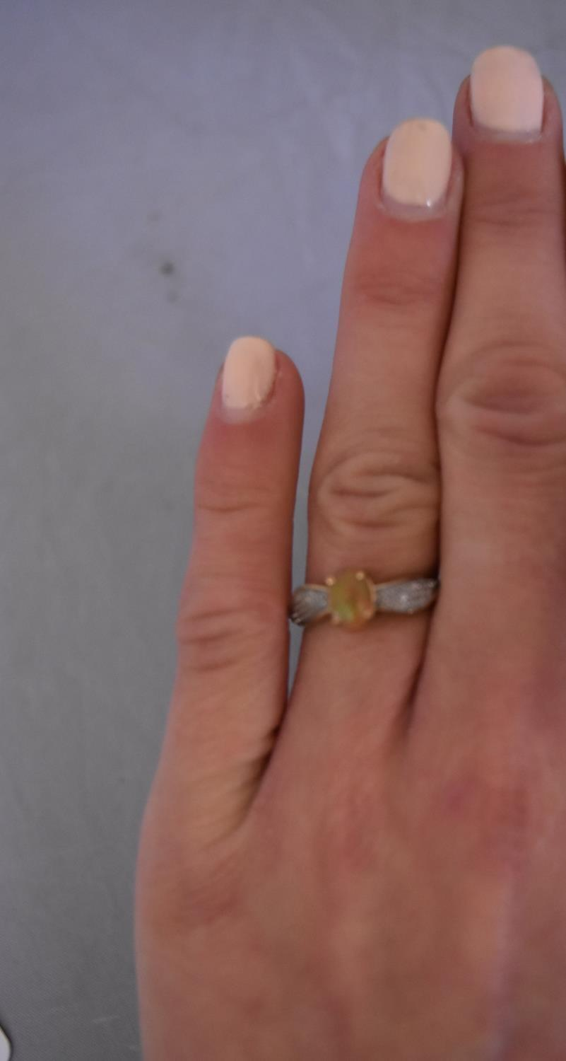 A modern Kalimaya opal and diamond flanked solitaire ring. Set to centre with an oval cabochon - Image 6 of 7