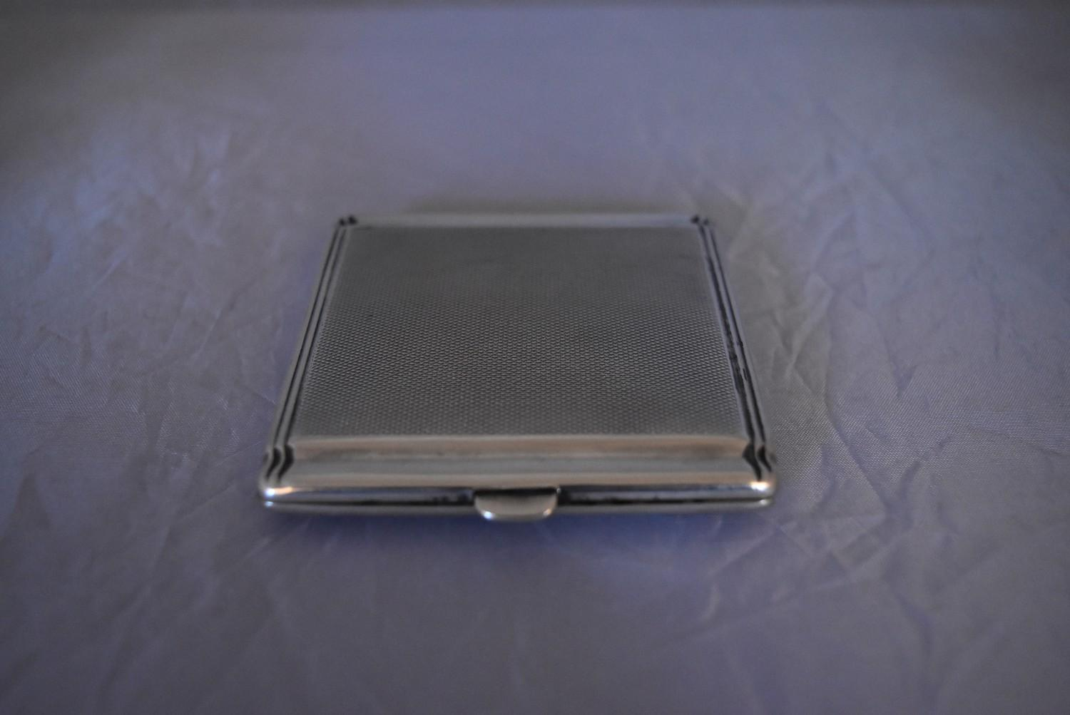 An Art Deco Continental silver cigarette case, marked 800. (62g)