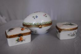 Three French Dubarry Limoges porcelain trinket boxes with floral design and gilded rope effect brass