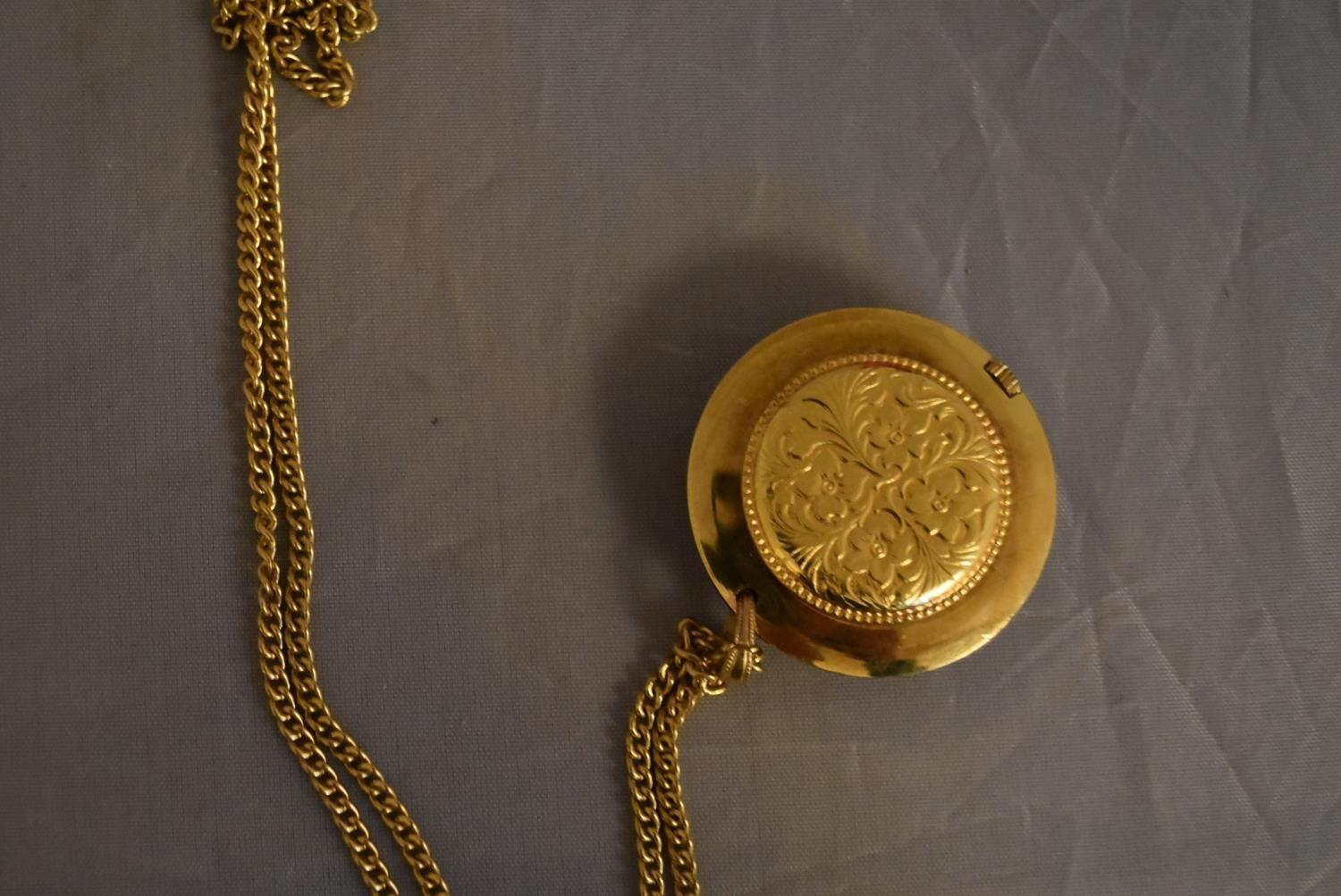 A vintage Tegrov gold tone pendant antimagnetic watch and chain. Impressed floral design to the back - Image 4 of 5