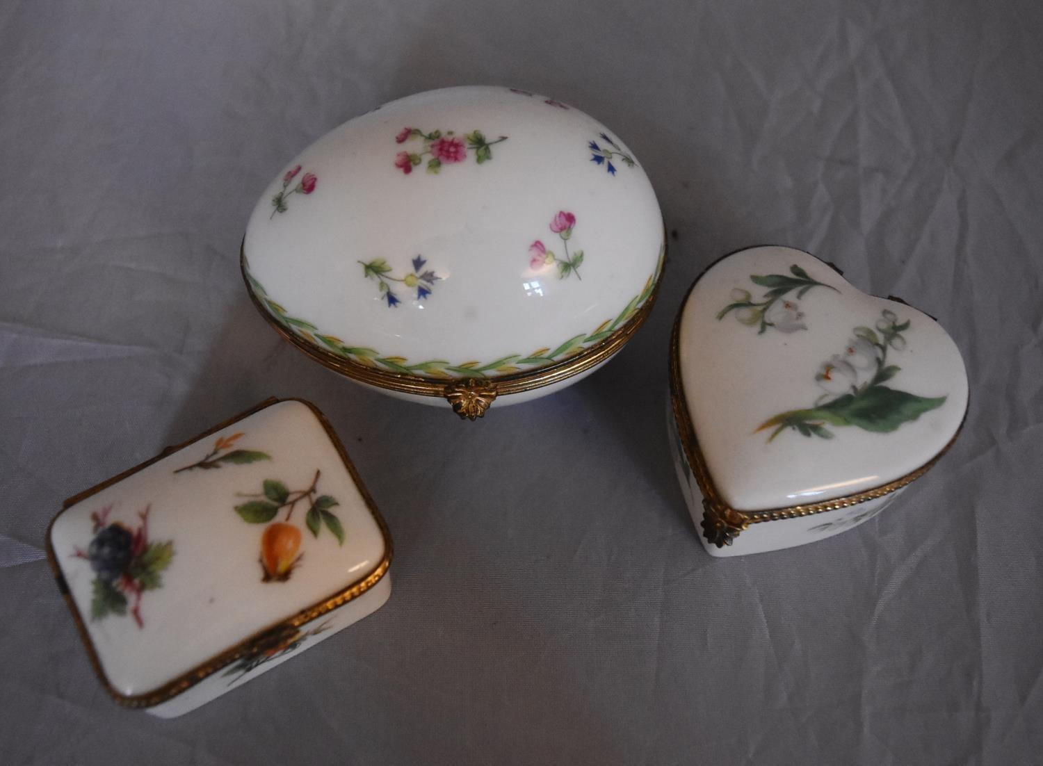 Three French Dubarry Limoges porcelain trinket boxes with floral design and gilded rope effect brass - Image 2 of 7