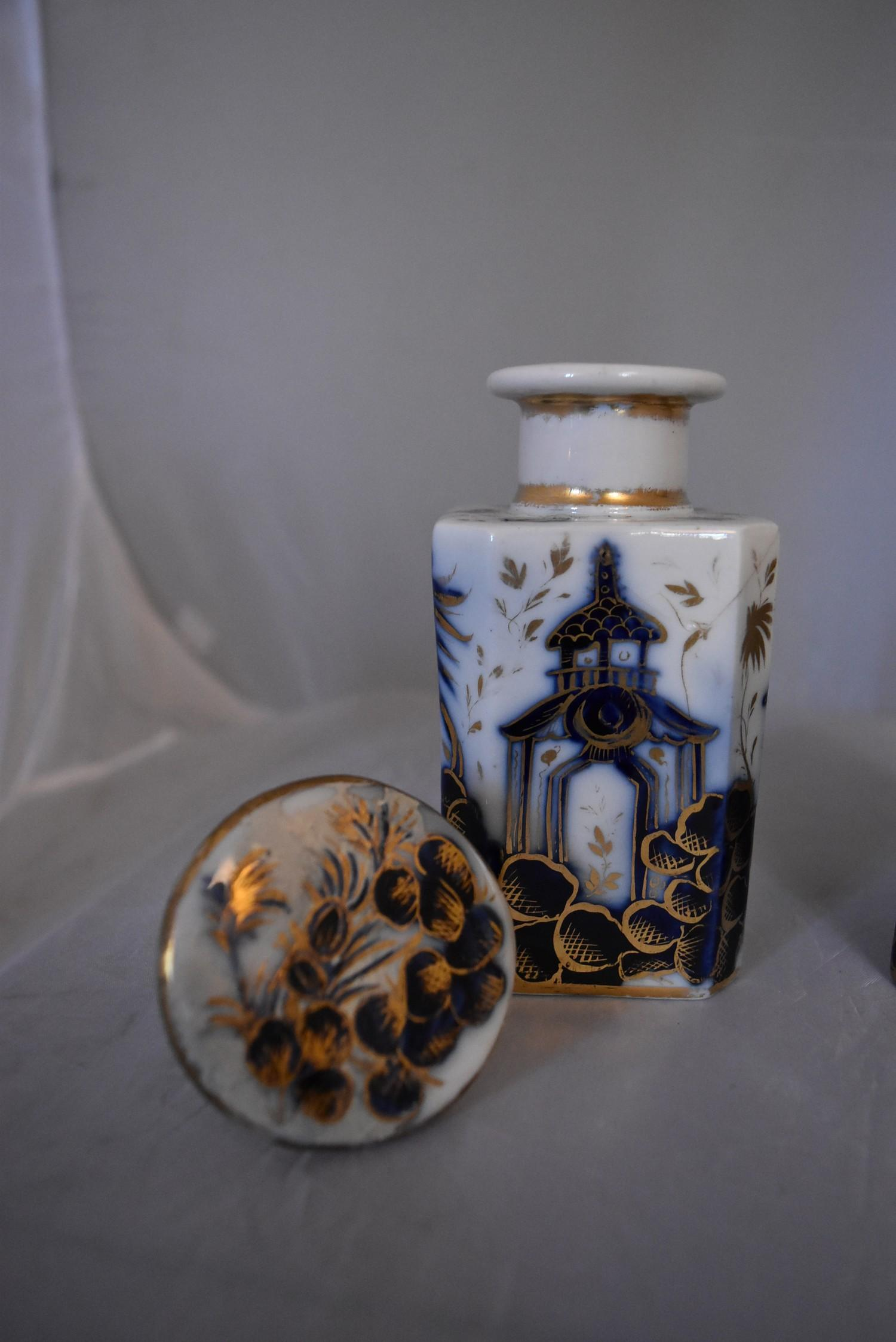 A pair of blue and white French porcelain scent bottles with oriental design and gilded accents. - Image 4 of 6