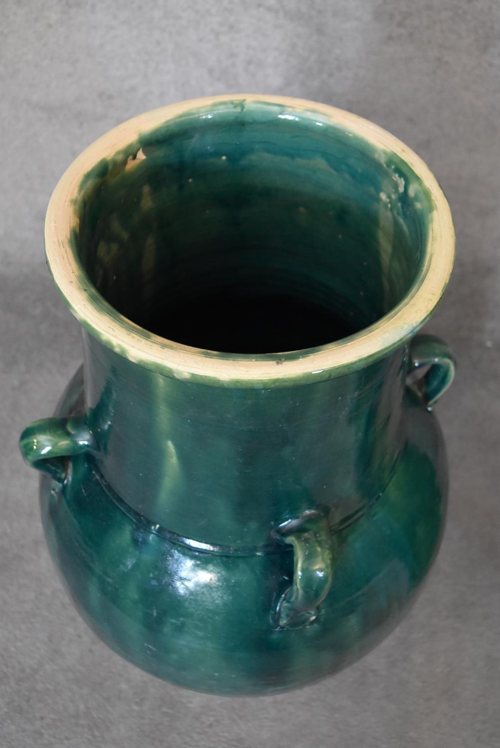 A pair of large green glazed sharab wine vessels. H.90 x 26cm - Image 2 of 5