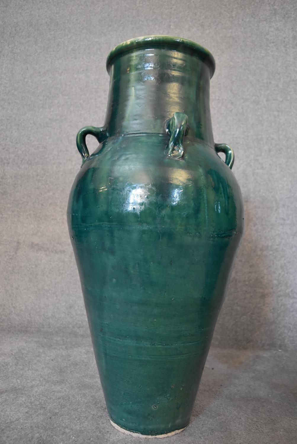 A pair of large green glazed sharab wine vessels. H.90 x 26cm - Image 4 of 5