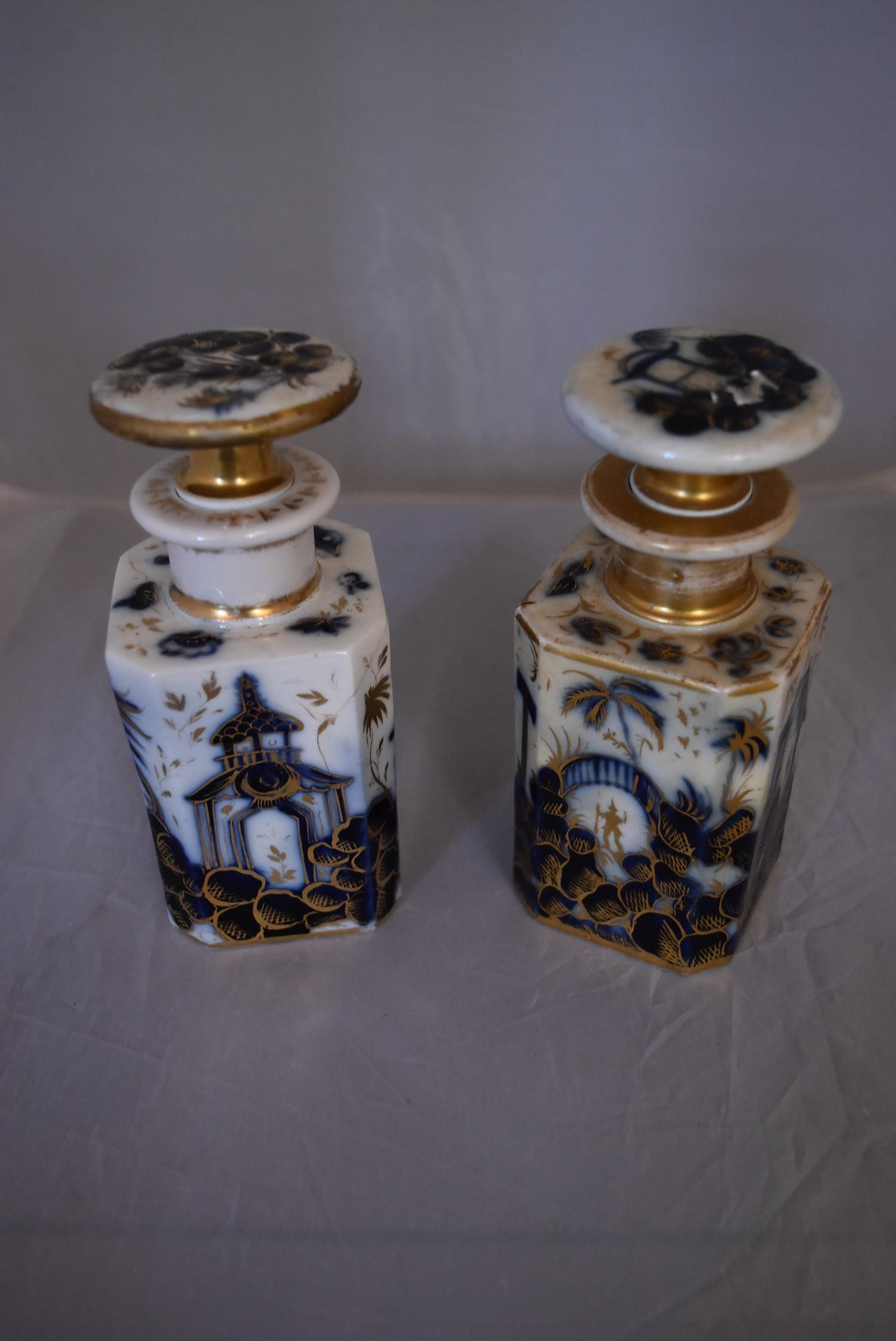A pair of blue and white French porcelain scent bottles with oriental design and gilded accents. - Image 2 of 6