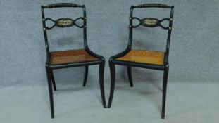 A pair of Regency ebonised caned seated chairs with rope twist top rails and brass eagle motifs,