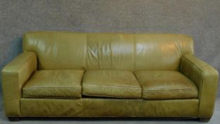 A pale green leather sofa raised on block feet. By Crate & Barrel. H.81 W.220 D.91cm