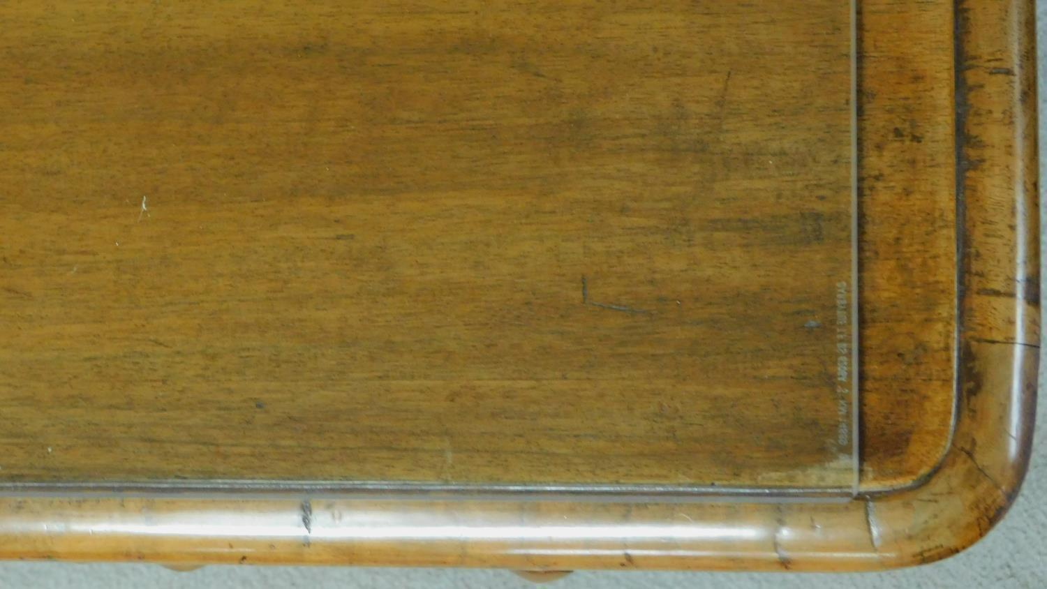 A William IV mahogany writing table with glass inset top and five frieze drawers, raised on tapering - Image 6 of 7