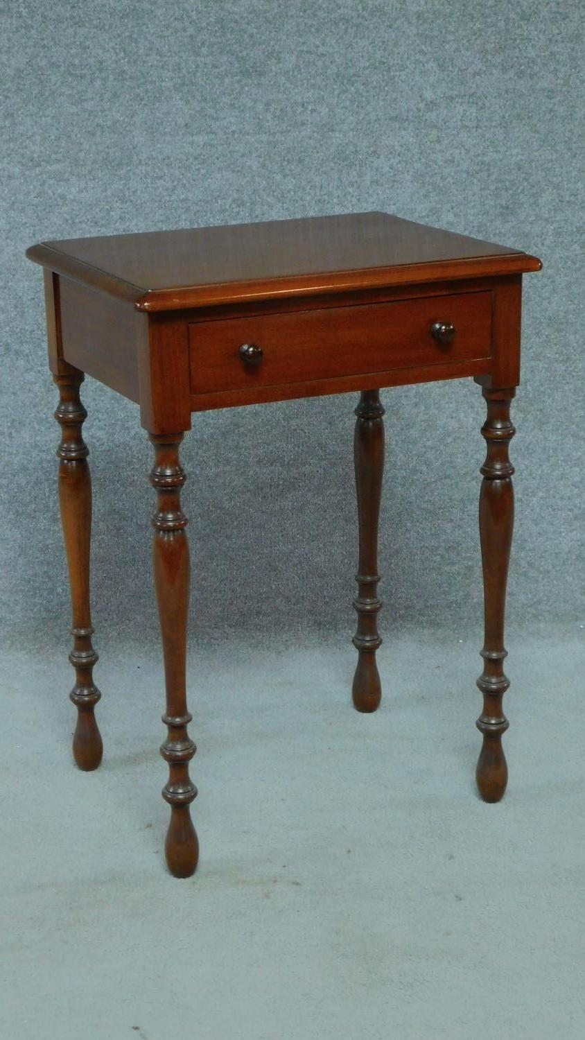 A late 19th century mahogany bedside table with frieze drawer, raised on turned tapering supports. - Image 3 of 5