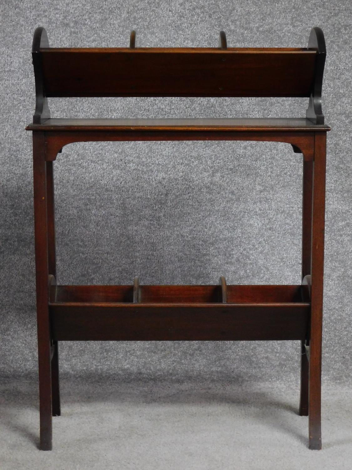 A late Victorian mahogany book trough with under tier, raised on square stretchered swept