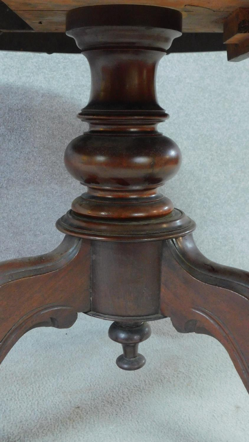 A Victorian mahogany circular dining table with tilt top action raised on carved tripod supports. - Image 4 of 7