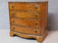 A Georgian style burr walnut chest of four long drawers on shaped bracket feet. H.82 W.79 D.50cm