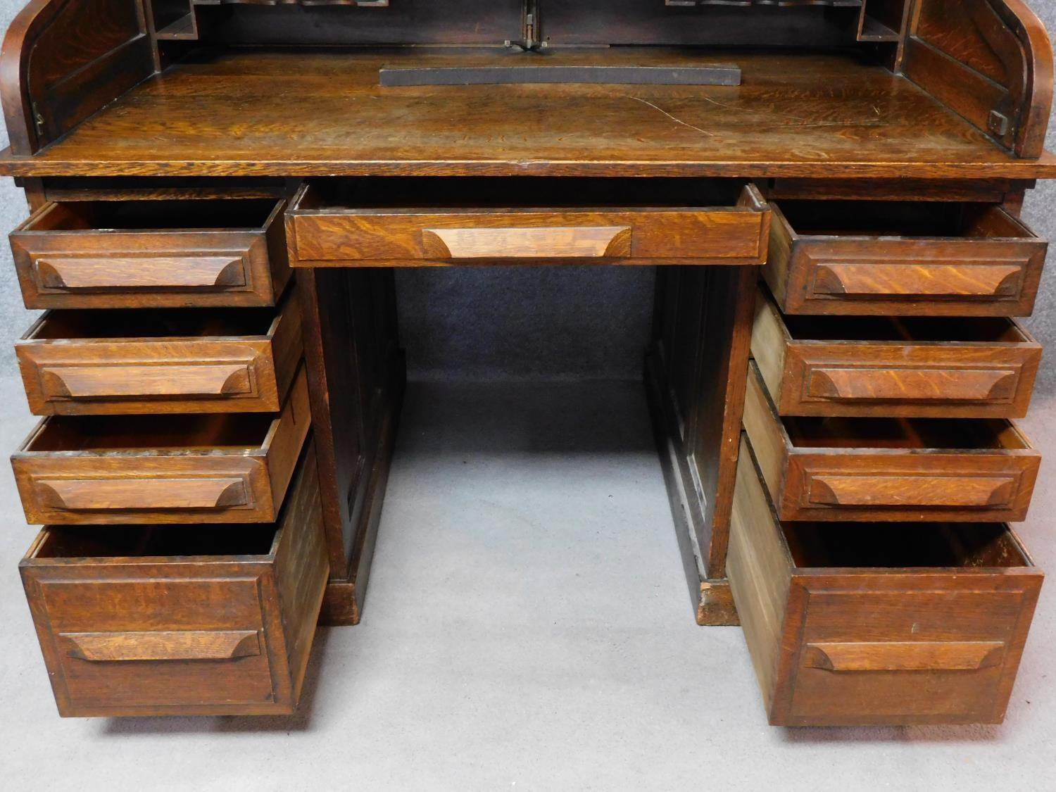 A late 19th century oak roll top desk with tambour shutter enclosing fitted interior above an - Image 3 of 9