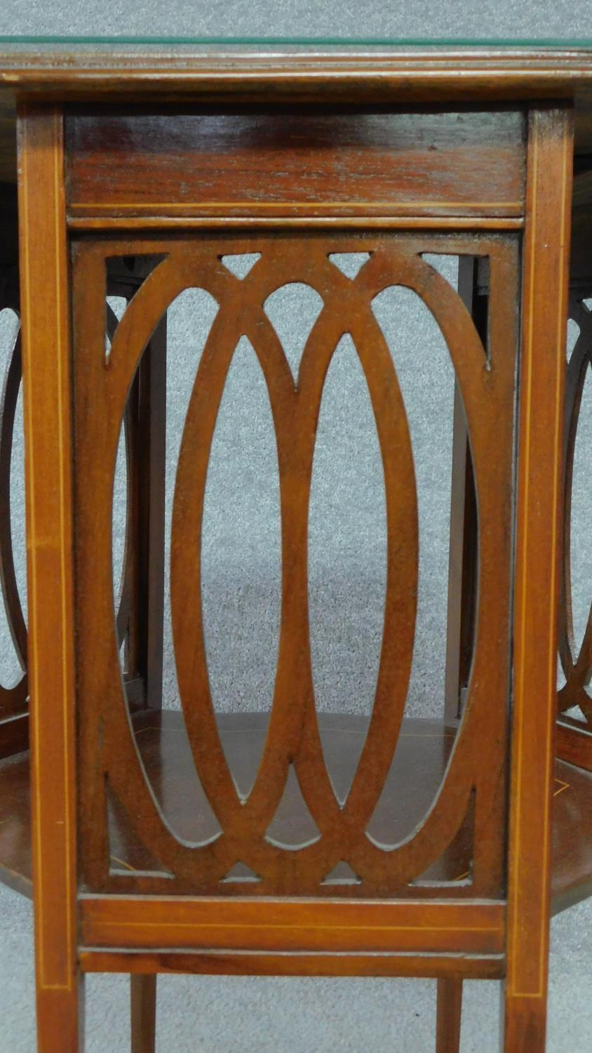 An Arts & Crafts mahogany and satinwood inlaid hexagonal carved lamp table raised on square tapering - Image 4 of 5