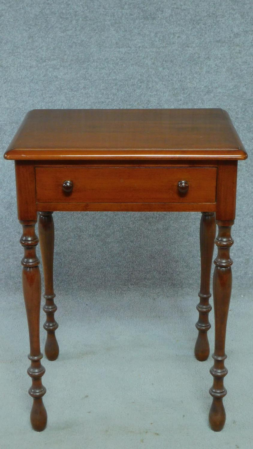 A late 19th century mahogany bedside table with frieze drawer, raised on turned tapering supports. - Image 2 of 5