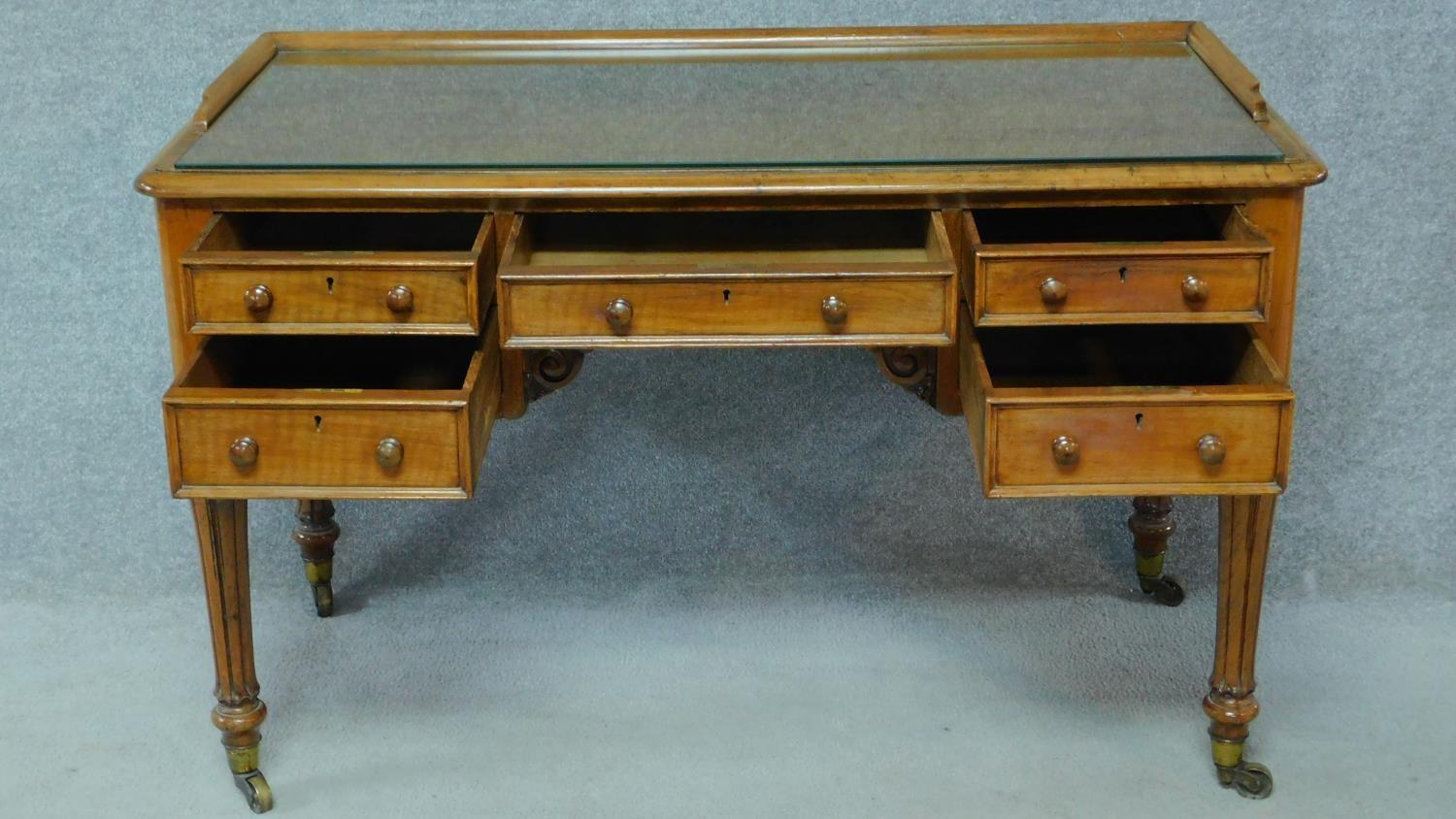 A William IV mahogany writing table with glass inset top and five frieze drawers, raised on tapering - Image 2 of 7