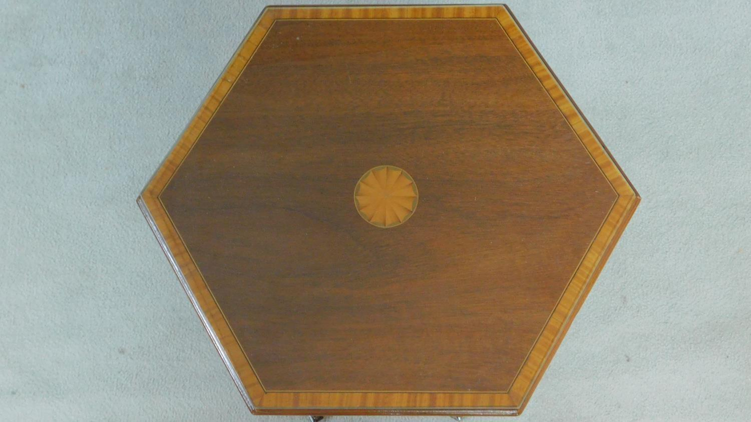 An Arts & Crafts mahogany and satinwood inlaid hexagonal carved lamp table raised on square tapering - Image 3 of 5