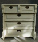 A 19th century continental painted chest of two short over three long drawers flanked by turned