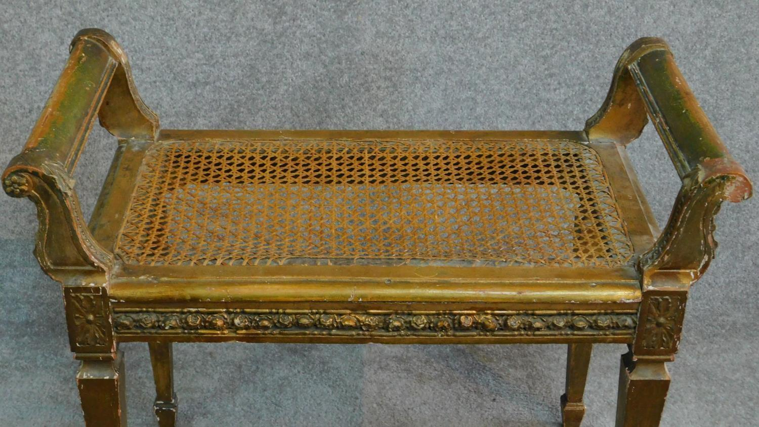 A Victorian gilt stool with caned seat on square tapering supports. H.59 W.69 D.36cm - Image 2 of 5