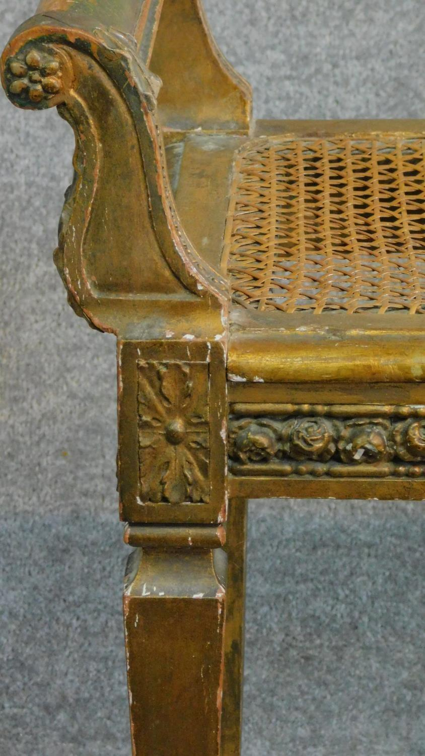A Victorian gilt stool with caned seat on square tapering supports. H.59 W.69 D.36cm - Image 3 of 5