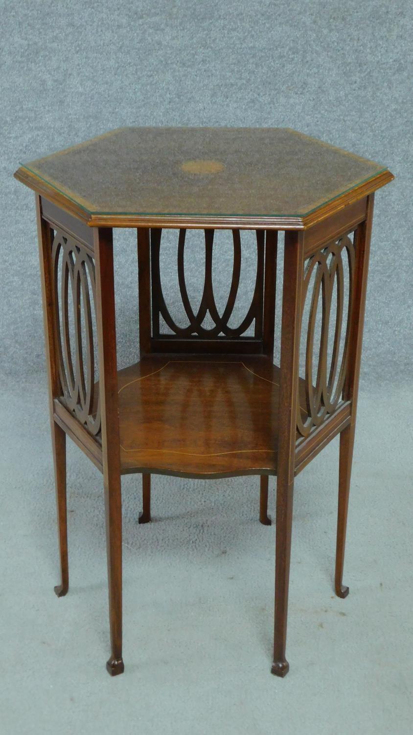 An Arts & Crafts mahogany and satinwood inlaid hexagonal carved lamp table raised on square tapering - Image 2 of 5