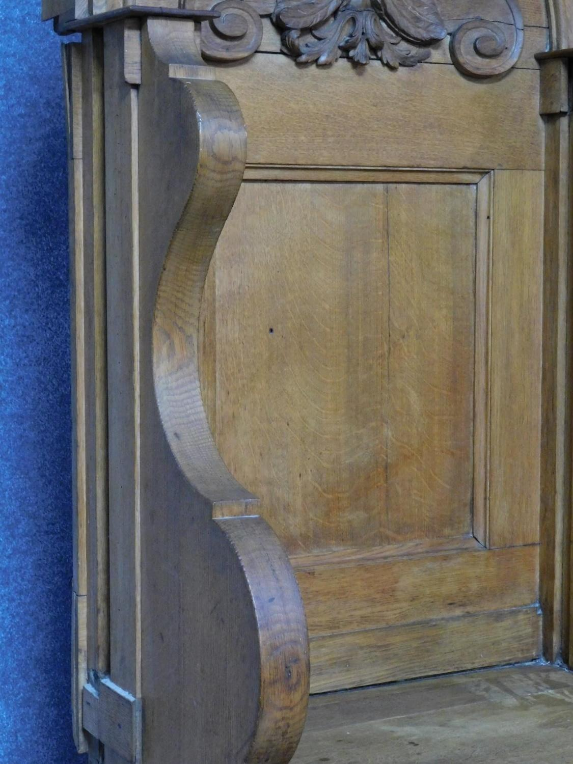 A 19th century oak hall bench with cherub carved mask above panel back on solid seat. H.169 W.75 D. - Image 4 of 7
