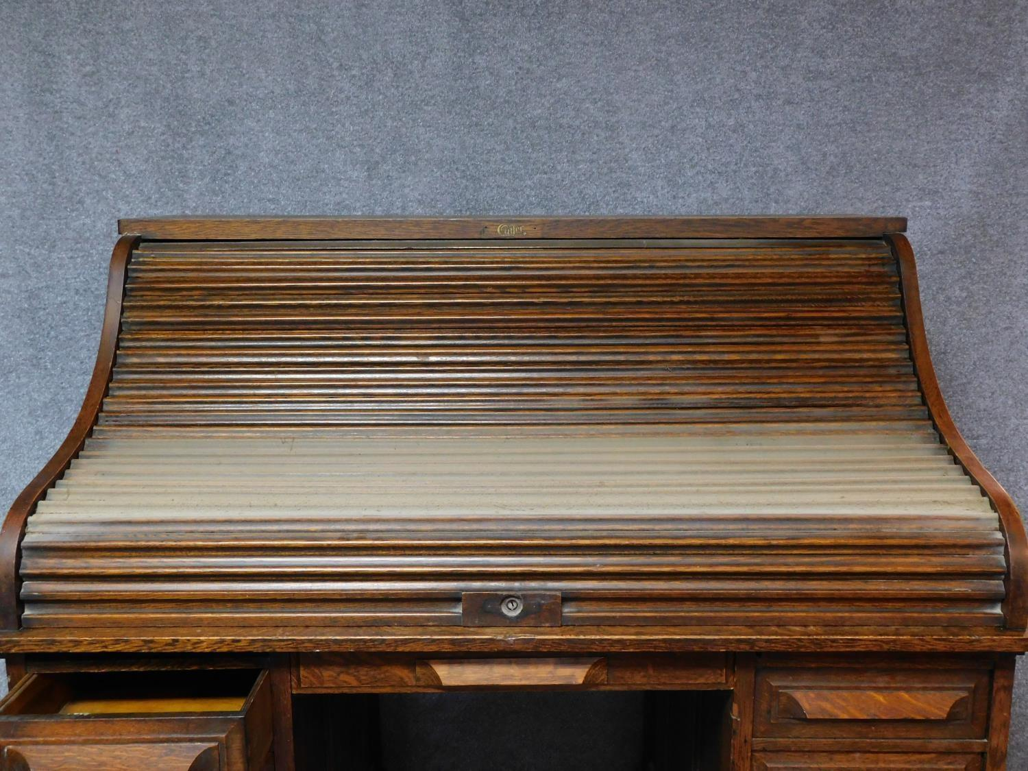 A late 19th century oak roll top desk with tambour shutter enclosing fitted interior above an - Image 4 of 9