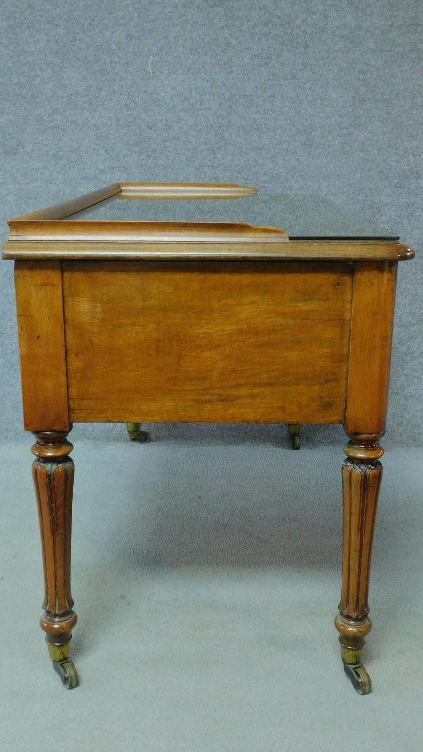 A William IV mahogany writing table with glass inset top and five frieze drawers, raised on tapering - Image 7 of 7