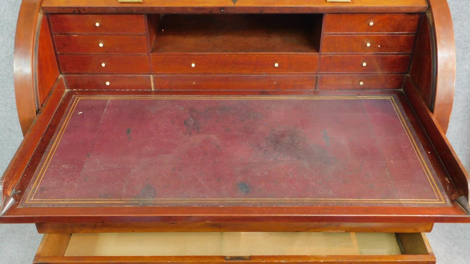 A 19th century continental mahogany cylinder top bureau with tooled leather lined slide out - Image 4 of 7