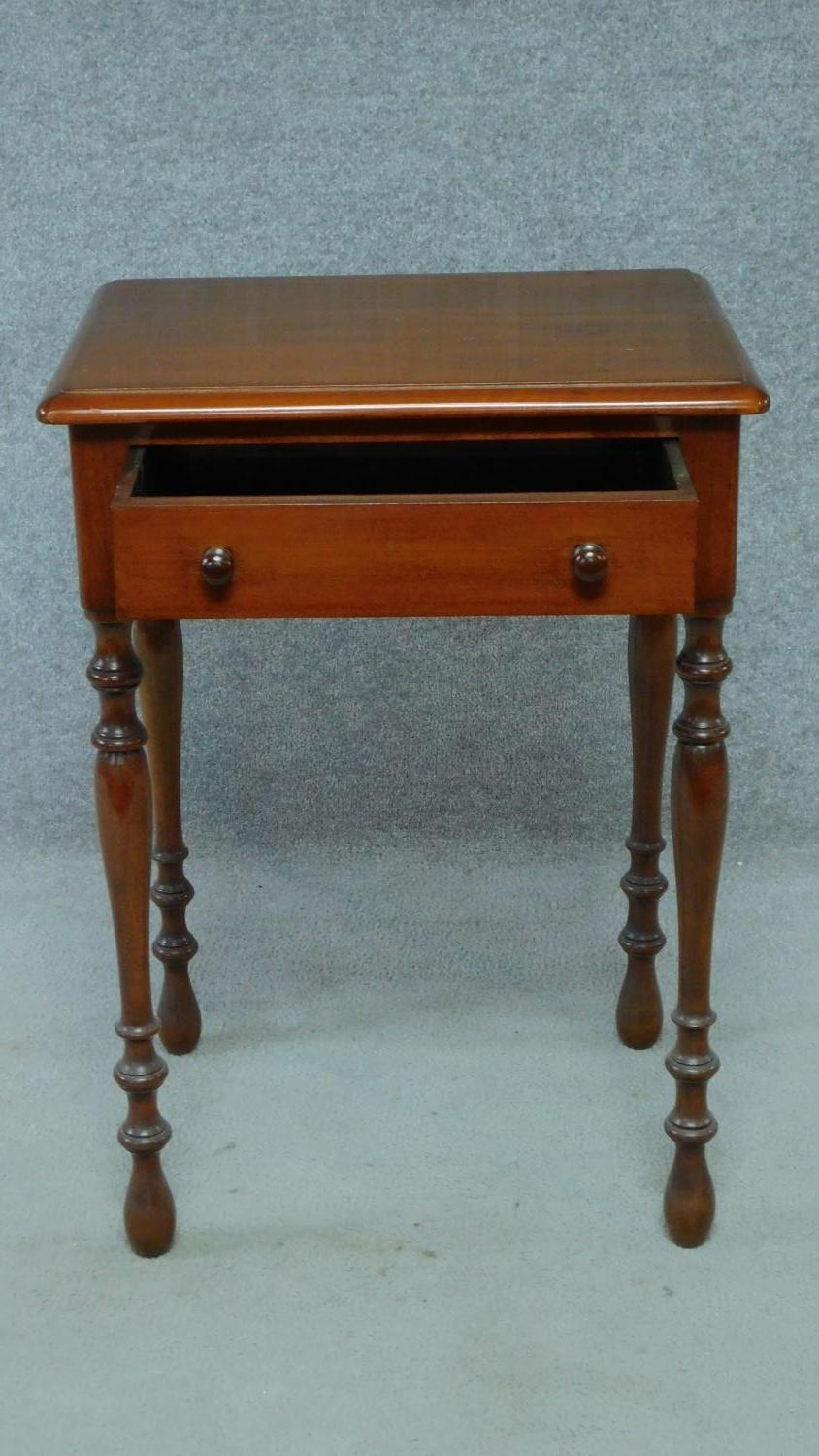 A late 19th century mahogany bedside table with frieze drawer, raised on turned tapering supports. - Image 4 of 5