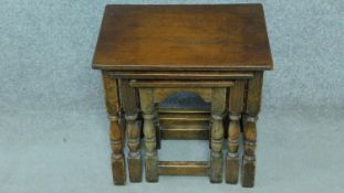 A Jacobean style oak nest of three tables on stretchered turned supports. H.43 W.44 D.31cm